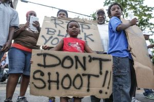 Yeah.  These signs are totally encouraging people to take up arms against police officers.